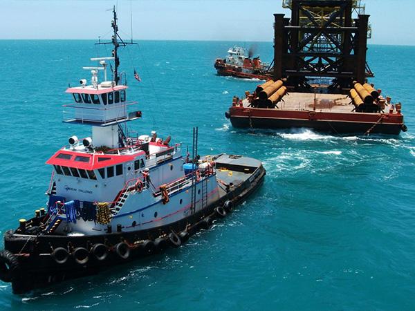 tug-boat-pulling-barge-california